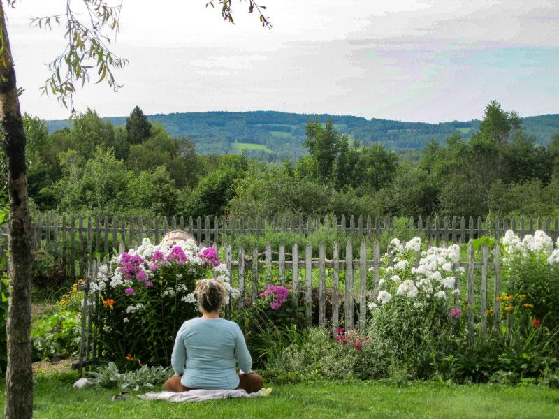 woman meditating at Rolling Meadows meditation retreat
