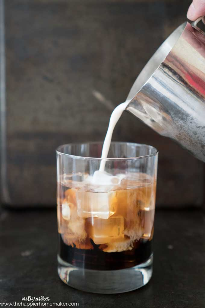 milk pouring into a glass of Pumpkin Spice White Russian fall cocktail