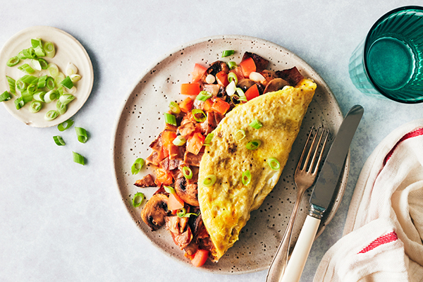 Hearty Omelet with Mushrooms, Tomato, Bacon, and Cheddar