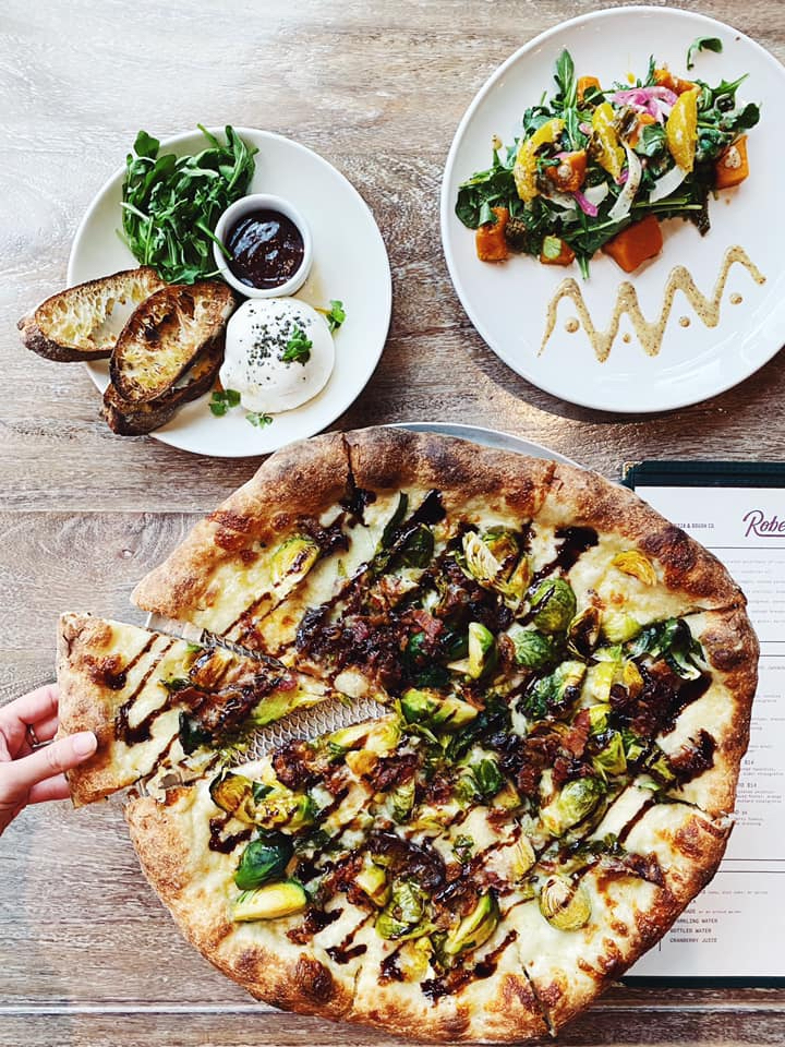 Menu items and pizza from Robert's Pizza and Dough in Chicago