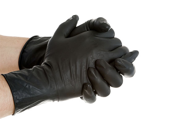 hands wearing black nitrile gloves