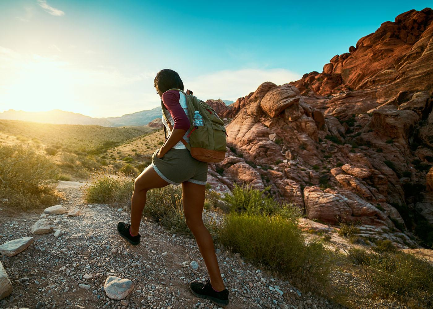 girl hiking on a trail