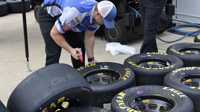 a technician prepping tires