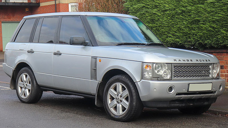 silver Land Rover Range Rover parked near a sidewalk