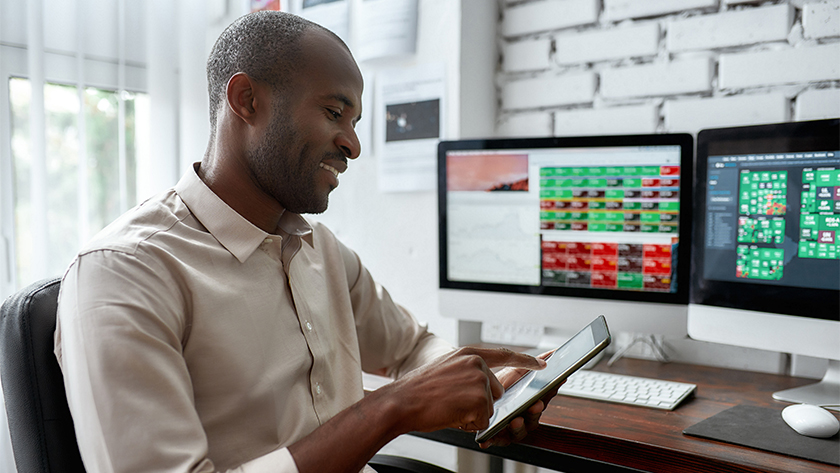 man looking at his stocks on his phone