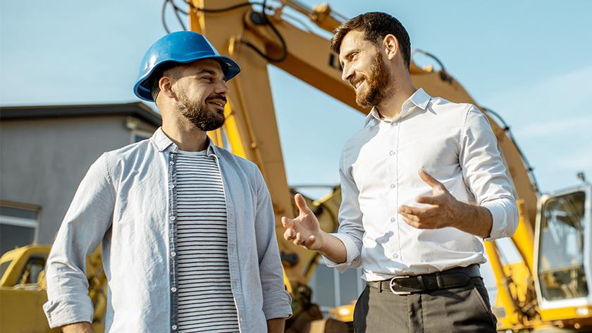men talking at a construction site