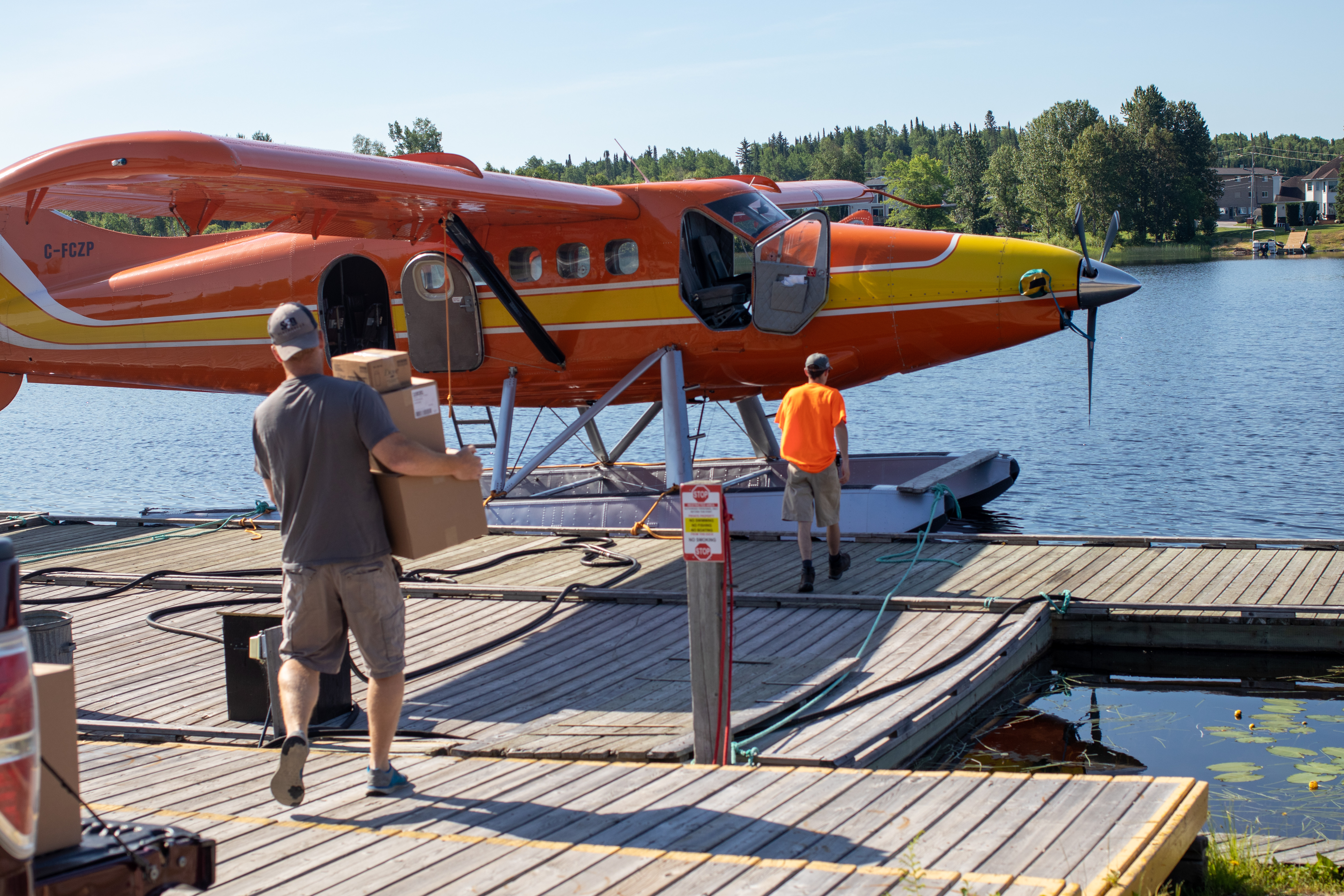 Volunteers load rescued food from Second Harvest onto a float plane in Sioux Lookout, ON