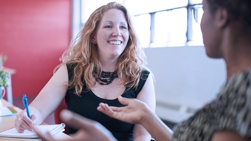 happy woman talking in a meeting