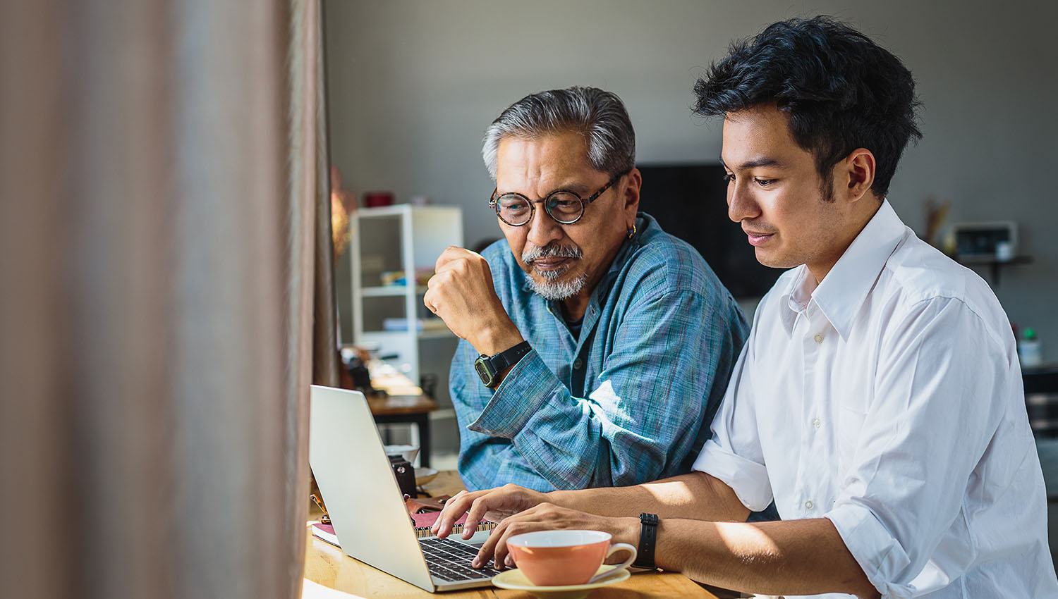 A father and son discuss what is a power of attorney over a computer