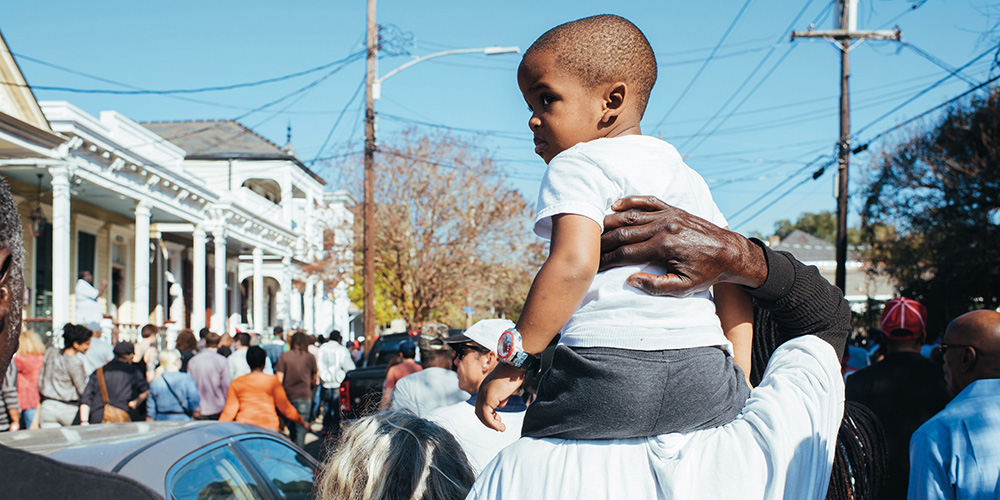 Child at Second Line parade in New Orleans.