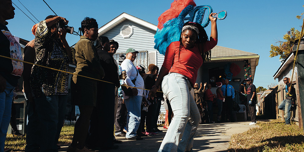 Second line parade in New Orleans dancer.