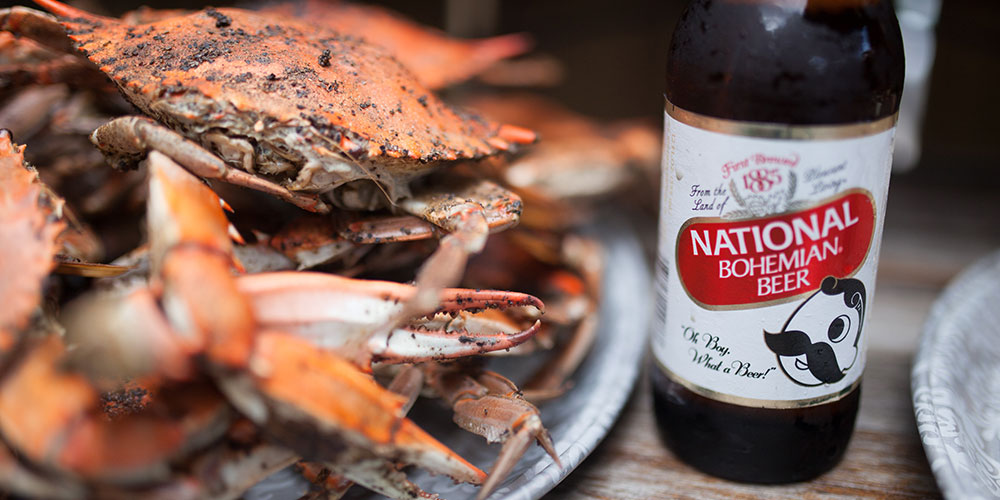Make your first meal in Baltimore a plate of steamed crabs with a Natty Boh. (Photo: Brian O'Doherty)