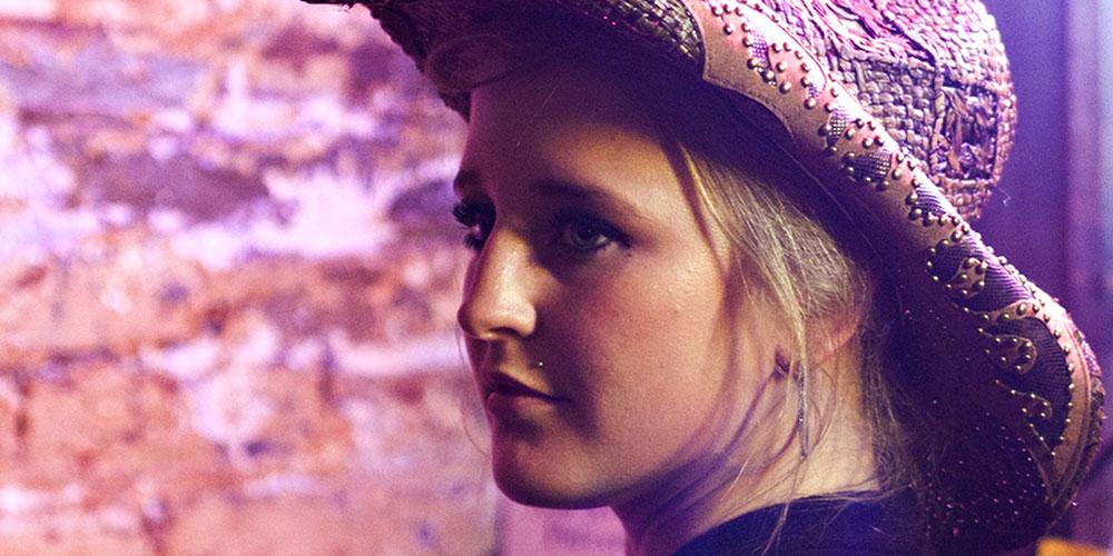 Girl in cowboy hat in Nashville.