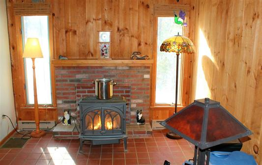 Fireplace 185 Reservoir Road, Campton, NH 03223 Alpine Lakes Real Estate