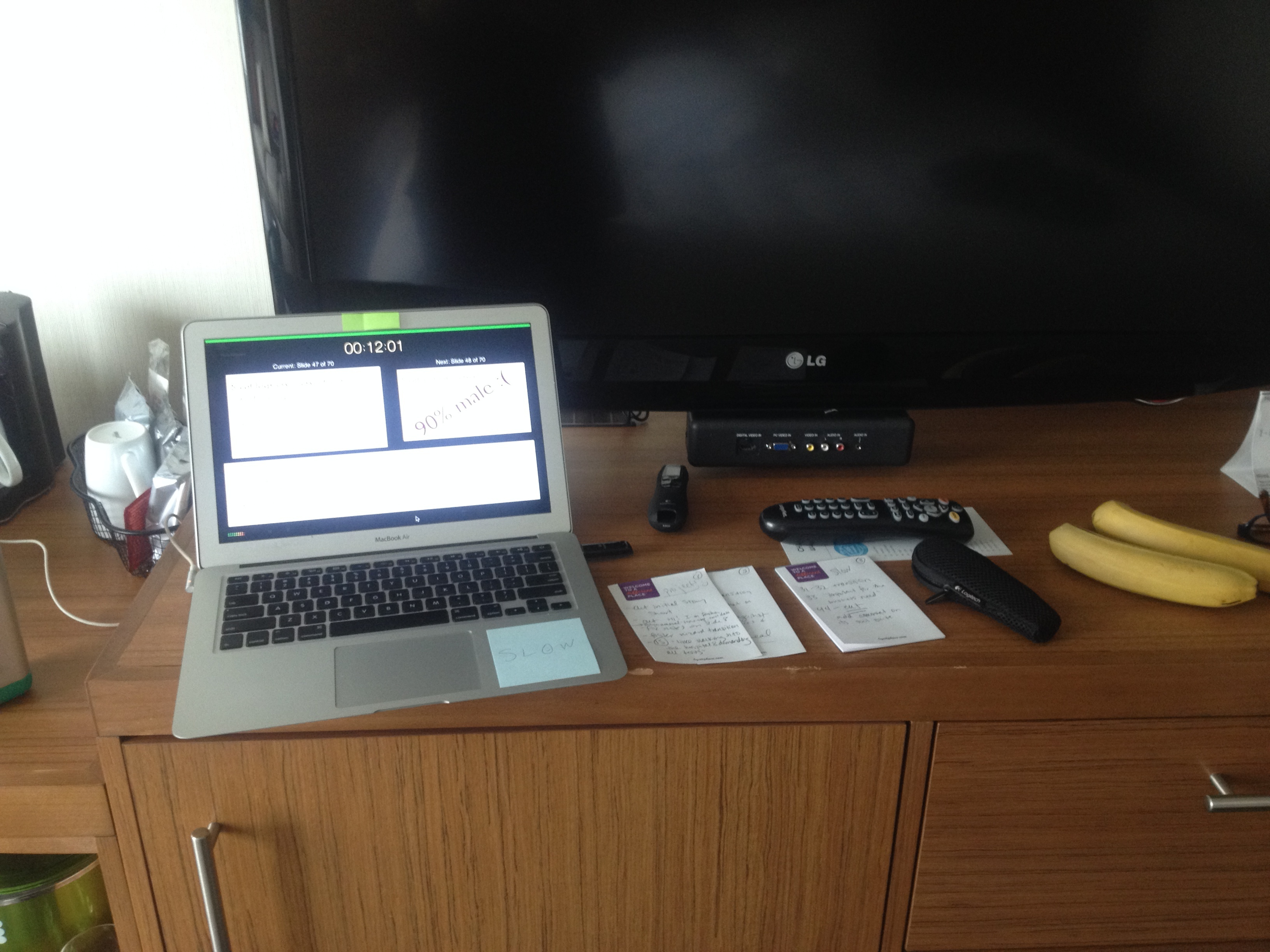 A picture of my laptop and notes on a hotel dresser.