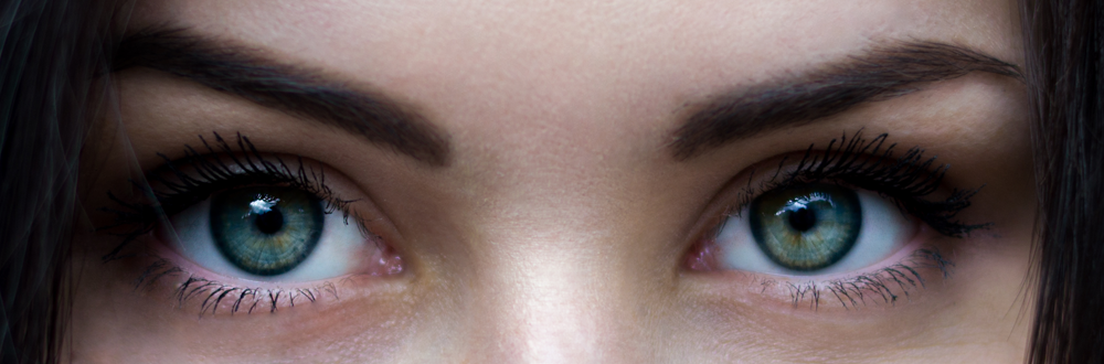 Close Up Photo of Woman with Mesmerizing Teal Blue Eyes with Flecks of Green and Amber