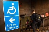 "Sign at top of Westminster tube station reads ""Lift to Trains"""