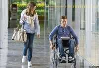 A student wheelchair user with his friend