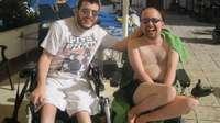 Ciaran sitting beside a swimming pool
