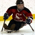 Playing sledge hockey with the Calgary Scorpions Sledge Hockey Club.