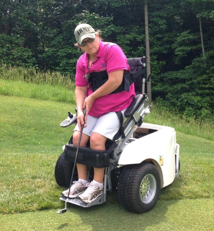 Tamara Lawter and Lt. Cpl. Mark Latynski use the ParaGolfer for both putting and teeing off.