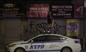 Azealia Banks dances on an NYPD car in the video for 'The Big Big Beat'