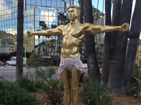 A life-size gold sculpture of Kanye West as Jesus has appeared in Hollywood