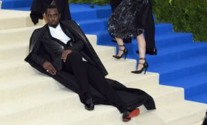 "Diddy ""got tired"" at the Met Gala so he lay down on the stairs in his floor-length cape"