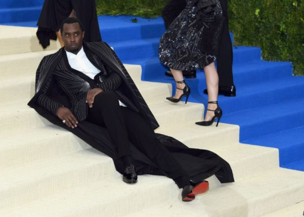 """Diddy """"got tired"""" at the Met Gala so he lay down on the stairs in his floor-length cape"""