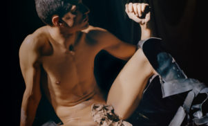 "Arca performs with a custom-built ""skin-activated"" dance pole at DAU world premiere"
