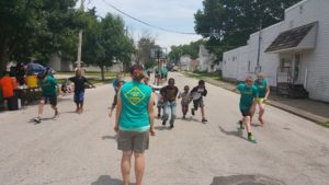 Faith Church 4:TWELVE Student Ministries teens playing Red Light, Green Light with neighborhood children in downtown Lafayette.