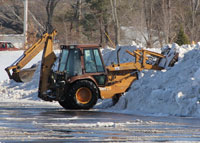 Snow being cleared from parking lot