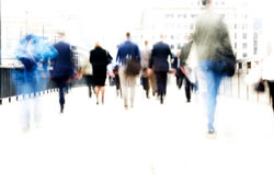Blurred picture of people moving in a city