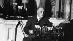 FILE - In this Jan. 6, 1941 file photo President Franklin D. Roosevelt adresses a joint session of Congress as  Speaker Sam Rayburn, left, and Vice President John N. Garner, look on.  With World War II looming, Roosevelt used his 1941 address to outline the