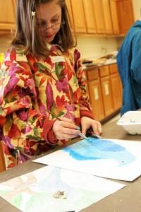 Elementary school girl painting