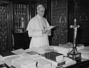 Pius XII at his desk.