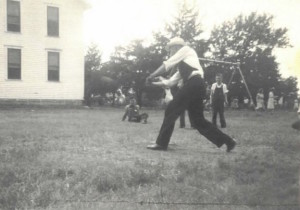 Fr. Emil Kapaun teaches baseball (Kansas, c. 1940)