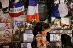 Mourners in Paris at a makeshift memorial for Father Hamel