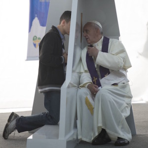 Pope Francis hears a confession at World Youth Day in Rio, 2013