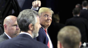 Trump points to Falwell Jr. (center): A sucker is born-again every minute.