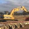 Cat 325cl Excavator and Drake Float & 2000 model Iveco