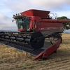2011 9895 class 8 Massey Combine with a  2009 Midwest 50 ft front 4 axle trailer