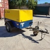 Compair C50 Portable diesel driven air compressor on a road tow trailer with lights