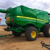 2013 John Deere S680 with 2013 12 Mtr 640 Draper front on 2016 Leith Trailer