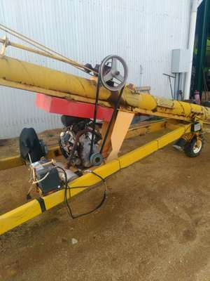 Keogh 55ft by 9inch auger with 35hp Kohler motor, power wheel and electric winch