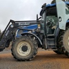 New Holland TS110A Tractor with Burder 8070 Loader