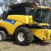 New Holland CR9070 Header(low hours) with 42'ft midwest front on trailer.