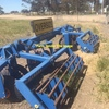Grizzly Track Renovator with Harrows