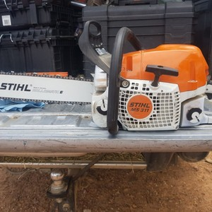 Stihl ms311 brand new $1100 firm with extras