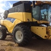 New Holland CR9060 Header With 42ft Honey Bee Front.
